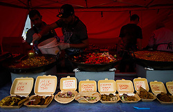 © Licensed to London News Pictures. <br /> 06/06/2014. <br /> <br /> Middlesbrough, England<br /> <br /> Food is prepared in a stall at the start of the 24th Middlesbrough Mela event.<br /> <br /> The Middlesbrough Mela has become the largest and most spectacular multicultural festival in the North East.<br /> <br /> Photo credit : Ian Forsyth/LNP