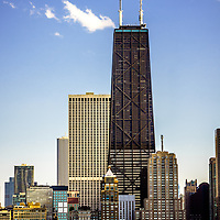 John Hancock Center building in Chicago.  The Hancock building is one of the most famous and tallest skyscrapers in the world and is a popular attraction in Chicago.