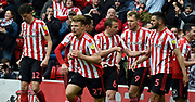 Sunderland players celebrate their first goal during the EFL Sky Bet League 1 match between Sunderland and Portsmouth at the Stadium Of Light, Sunderland, England on 27 April 2019.