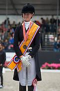 Podium Nederlands Kampioenschap Young Riders 1. Denise Nekeman & Boston STH, 2. Jeanine Nekeman & Vlingh STH, 3. Rosalie Bos - Equestricons Bolita<br /> Nederlands Kampioenschap Young Riders 2015<br /> © DigiShots