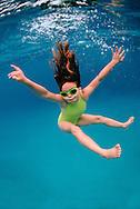 Young girl jumps poses infront of camera. Tonga.