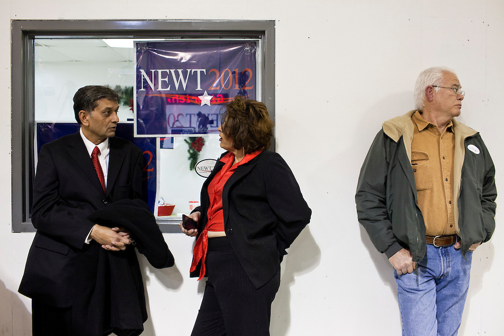 People wait for Republican presidential candidate Newt Gingrich to arrive for a rally at his campaign office on Monday, January 2, 2012 in Davenport, IA.