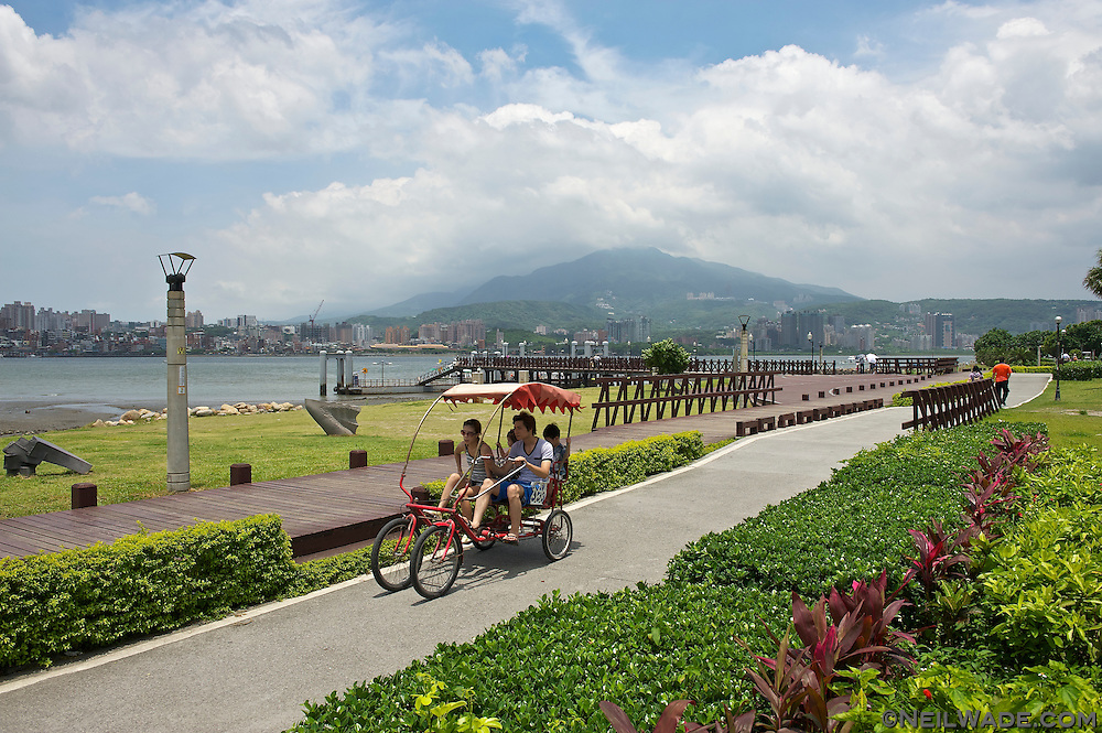A family rides a four person bicycle on The Bali Left Bank Bike Trail.