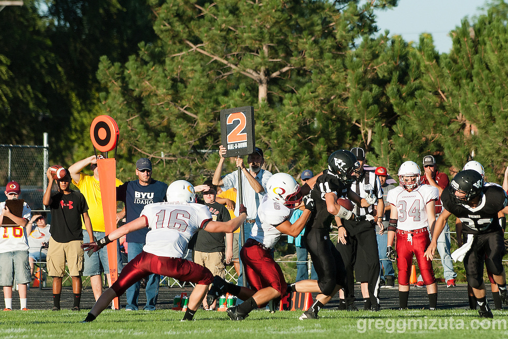 Ontario's Mandon Morin attempts to tackle Vale senior Colton Friend in the season opener Friday August 30, 2013 at Frank Hawley Stadium in Vale, Oregon. Vale won the game 29-21.
