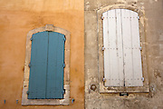 Parallel doors, Arles, France.<br /> <br /> Arles was first inhabited in the seventh century BC as a Phoenician trading center on the Rhone River, and shows signs of Greek influence owing to archaeological evidence and pottery of Greek design. Arles later became a Celtic-Ligurian town in the third century BC and, then in the first century BC, a Gallo-Roman city.<br /> <br /> The Roman-era arena similar to Rome's Coliseum is so well preserved that it is still the major arena of the city and is used for bullfighting and other traditional festivals.