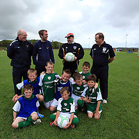 Dermot Mahoney, Paul Mahoney, James Drury and Matthew Kelly with the U-11's at the Moneypoint FC Summer Soccer Camp in Kilrush on Wednesday.<br /> Photograph by Yvonne Vaughan