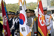 A guard of honor is formed during a commemorative event to mark the 60th anniversary of the start of the Korean War at the National Cemetery in Seoul, South Korea on 23 June, 2010..Photographer: Rob Gilhooly .