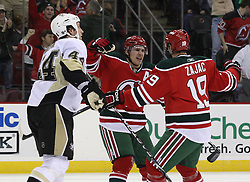 Mar 17, 2010; Newark, NJ, USA; New Jersey Devils left wing Zach Parise (9) and New Jersey Devils center Travis Zajac (19) celebrate a goal by New Jersey Devils left wing Zach Parise (9) during the second period at the Prudential Center.