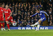 Eden Hazard of Chelsea shoots during the Capital One Cup Semi Final 2nd Leg match between Chelsea and Liverpool at Stamford Bridge, London, England on 27 January 2015. Photo by David Horn.