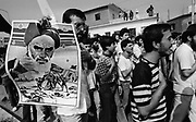 Beirut, Lebanon June 21st 1985. Airport road. Shiite Hezb'Allah demonstrators, beating their chest and waving posters of Iranian guide Ayatollah Khomeiny,  marching toward the Beirut airport were a TWA airplane with passengers and crew menbers onboard, is sized by islamists hijackers. ©Herve Merliac