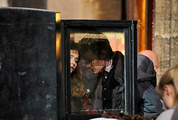 © Licensed to London News Pictures. 20/08/2012. Bristol, UK. Actors Matt Smith (right) and Jenna-Louise Coleman (left in carriage) on set as the BBC's Dr Who film around Corn Street in Bristol's old city centre.  Fake snow was used for a winter scene with Matt Smith as Doctor Who dressed in a top hat, doing a scene with a horse drawn carriage and the new doctor's companion Jenna-Louise Coleman.  20 August 2012..Photo credit : Simon Chapman/LNP