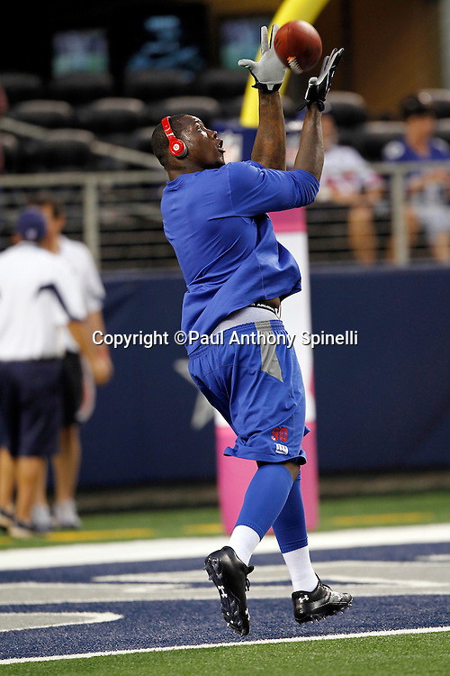 New York Giants defensive end Jason Pierre-Paul (90) catches a pregame pass during the NFL week 7 football game against the Dallas Cowboys on Monday, October 25, 2010 in Arlington, Texas. The Giants won the game 41-35. (©Paul Anthony Spinelli)