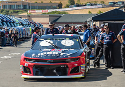 June 22, 2018 - Sonoma, CA, U.S. - SONOMA, CA - JUNE 22: The crew for William Byron, driving the #(24) Chevrolet for Hendrick Motorsports lines up for inspections on Friday, June 22, 2018 at the Toyota/Save Mart 350 Practice day at Sonoma Raceway, Sonoma, CA (Photo by Douglas Stringer/Icon Sportswire) (Credit Image: © Douglas Stringer/Icon SMI via ZUMA Press)