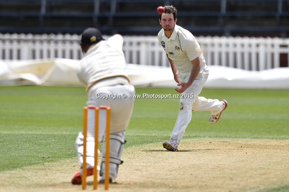 Bradley Scott (R of the Volts bowls to Michael Pollard of the Firebirds during the Plunket Shield cricket match -between the Wellington Firebirds and Otago Volts on Thursday 17 December 2015 at the Basin Reserve, Wellington. Copyright Photo: Marty Melville  / www.photosport.nz