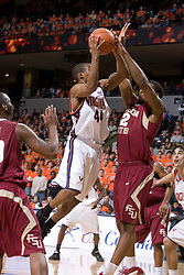 Florida State Seminoles forward Ryan Reid (42) blocks a shot from Virginia Cavaliers point guard Sean Singletary (44).  The Virginia Cavaliers Men's Basketball Team defeated the Florida State Seminoles 73-70 at the John Paul Jones Arena in Charlottesville, VA on February 17, 2007.