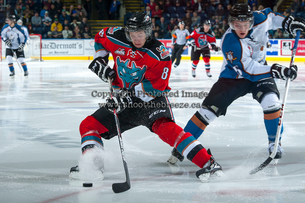 KELOWNA, CANADA - DECEMBER 7: Colten Martin #8 of the Kelowna Rockets moves the puck up the ice against the Kootenay Ice on December 7, 2013 at Prospera Place in Kelowna, British Columbia, Canada.   (Photo by Marissa Baecker/Shoot the Breeze)  ***  Local Caption  ***