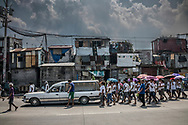 "Friends and family of Junmar Abletes, 27 years old, follow the hearse carrying his body to the Navotas Catholic Cemetery.  Junmar was killed in an extrajudicial killing as part of President Duterte's ""War on Drugs"".  Junmar had moved to the island of Samar, over 600 km away (370 miles).    While back on a family visit, he was assassinated in Market 3 slum in Navotas, where his family lives.  Funeral processions like this  for young men and women have been all too common in the past year since the ""War on Drugs"" known locally as ""Tokhang"" began.  Navotas, Metro Manila, Philippines"