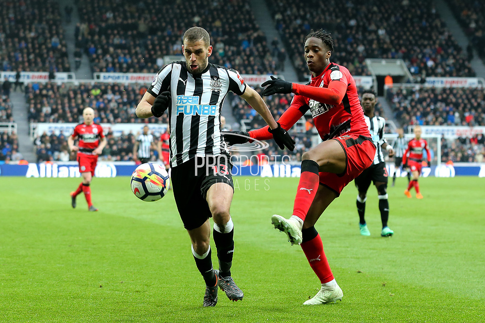 Islam Slimani (#13) of Newcastle United holds off the challenge of Terence Kongolo (#5) of Huddersfield Town during the Premier League match between Newcastle United and Huddersfield Town at St. James's Park, Newcastle, England on 31 March 2018. Picture by Craig Doyle.