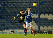 York City striker Vadaine Oliver beats Portsmouth defender Adam Webster to the ball during the Sky Bet League 2 match between Portsmouth and York City at Fratton Park, Portsmouth, England on 24 November 2015. Photo by Adam Rivers.