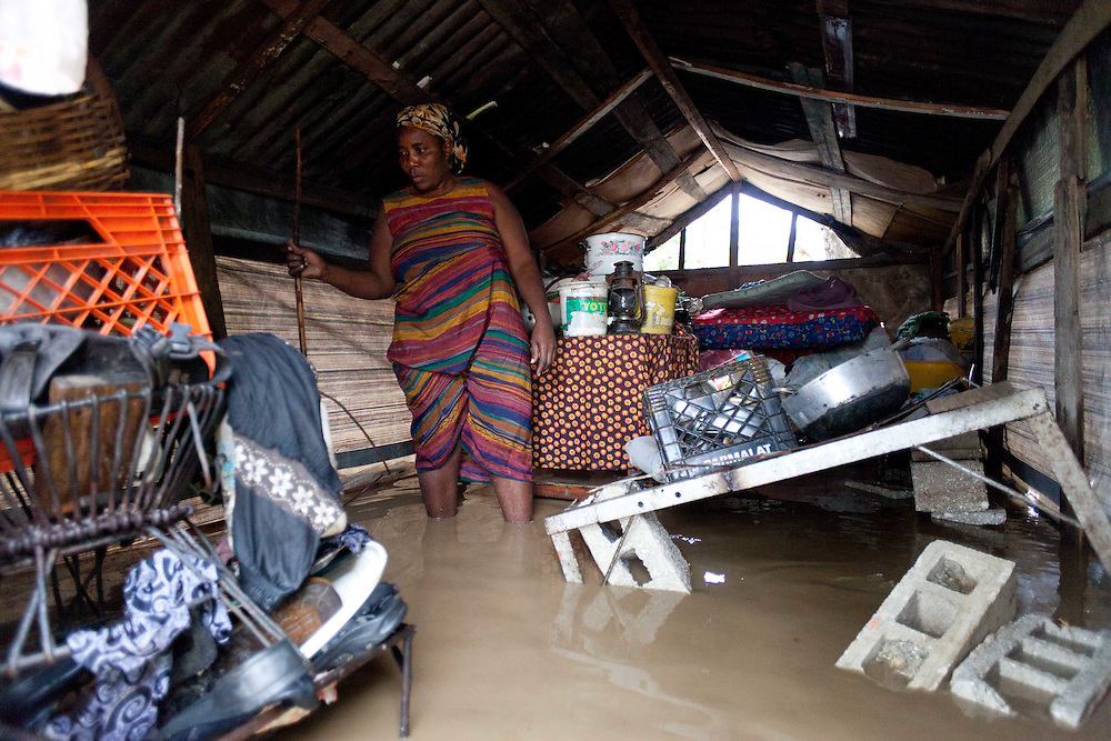 Vierge Dieula in her tarp shelter flooded by rain from Hurricane Tomas. Dieula lost her home in the January 12th earthquake and since then has been living in this shelter in the median of a road with three of her children.