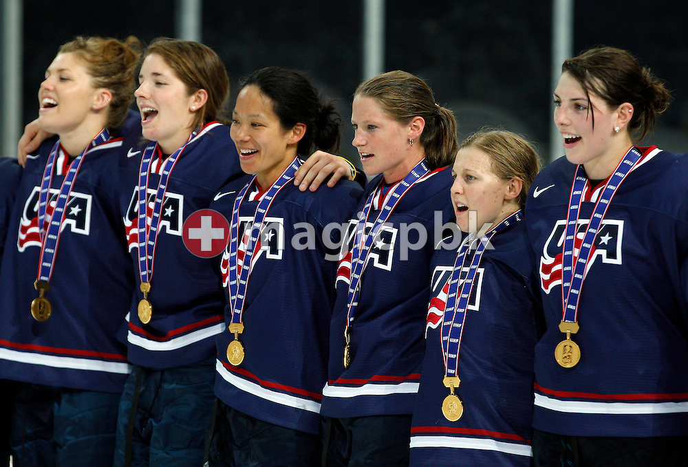 USA's forward Kendall COYNE (2nd R) and her teammates sing the national anthem after a 3-2 victory in overtime in the IIHF World Women Championship Gold medal ice hockey game between the USA and Canada in Zurich, Switzerland, Monday, April 25, 2011. (Photo by Patrick B. Kraemer / MAGICPBK)