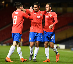 Costa Rica's Marco Urena (21) celebrates with Daniel Colindres and Bryan Oviedo (left) after scoring his side's first goal of the game