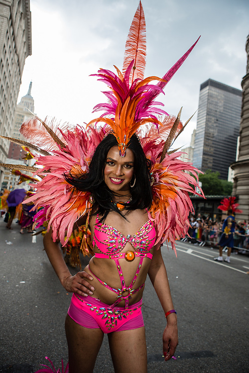 New York, NY - 25 June 2017. New York City Heritage of Pride March filled Fifth Avenue for hours with groups from the LGBT community and it's supporters. A marcher from the Caribbean Equality Project wears an elaborate costume.