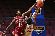 LAS VEGAS, NV - DECEMBER 23:  Jeff Pollard #13 of the Washington State Cougars blocks a shot from Ahmed Ali #23 of the Washington State Cougars late in the second half during the consolation game of the Continental Tire Las Vegas Classic at the Orleans Arena in Las Vegas, Nevada. New Mexico State defeated Washington State 75-72.  (Photo by Sam Wasson for NM State Athletics)