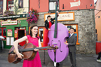08/09/2014 Repro Free , Sarah Joyce, cellist   with Beau Holland, stiltwalker with Finghin Collins, Artistic Director (Music for Galway) at the launch of Music for Galway's 34th International Concert Season.  <br /> Picture:Andrew Downes