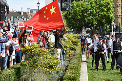 "© Licensed to London News Pictures. 17/08/2019. LONDON, UK.  Pro China demonstrators in Parliament Square take part in a counter protest against a solidarity rally for the people of Hong Kong.  Similar ""Global Solidarity with Hong Kong"" rallies are taking place worldwide as protests in the former British colony enter their tenth week demanding democratic reforms and a halt to police brutality.  Photo credit: Stephen Chung/LNP"