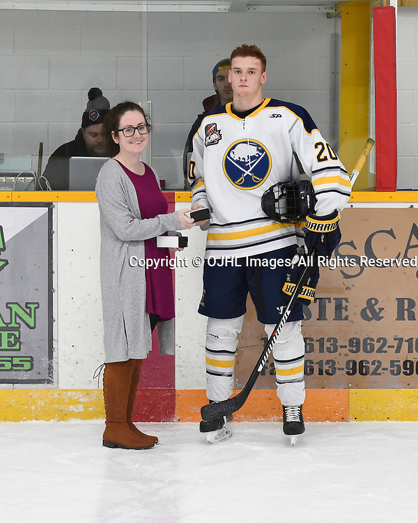 TRENTON, ON - JAN 25,  2017: Ontario Junior Hockey League game between North York and Buffalo at the 2017 Winter Showcase , Erik Urbank #20 of the Buffalo Jr. Sabres receives the player of the game award from Trenton Golden Hawks Director of Public Relations Jodie Carmichael.  <br /> (Photo by Andy Corneau / OJHL Images)