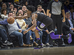 December 12, 2017 - Sacramento, CA, USA - The Sacramento' guard De'Aaron Fox hustles to save the ball before it goes out of bounds against the Phoenix Suns on Tuesday, Dec. 12, 2017, at the Golden 1 Center in Sacramento, Calif. (Credit Image: © Hector Amezcua/TNS via ZUMA Wire)