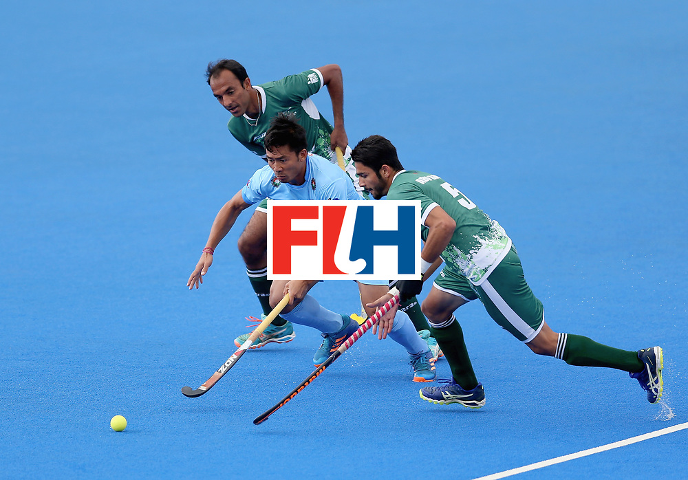 LONDON, ENGLAND - JUNE 24: Chinglensana Kangujam of India and Abu Mahmood of Pakistan battles for possession during the 5th-8th place match between Pakistan and India on day eight of the Hero Hockey World League Semi-Final at Lee Valley Hockey and Tennis Centre on June 24, 2017 in London, England. (Photo by Steve Bardens/Getty Images)