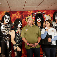 KISS band  members Gene Simmons , Eric Singer , Paul Stanley and Tommy Thayer with retired U.S. Army Staff Sgt. John Hosea and his wife Sarah .The Combat-Wounded Hero recipient of the newly-renovated, mortgage-free home .