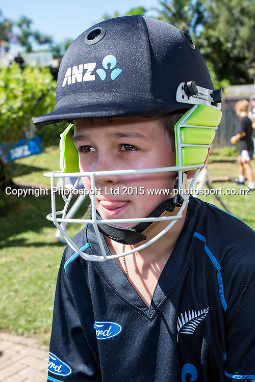 Lukasz tries on his new ANZ cricket helmet. Brothers Lukasz (10) and Kazik (8) Swain from Sandringham, winners of the ANZ Field Your Dream competition had their front yard transformed to play cricket and meet their Blackcap heroes, Auckland, New Zealand, Sunday, January 18, 2015. Copyright photo: David Rowland/www.photosport.co.nz