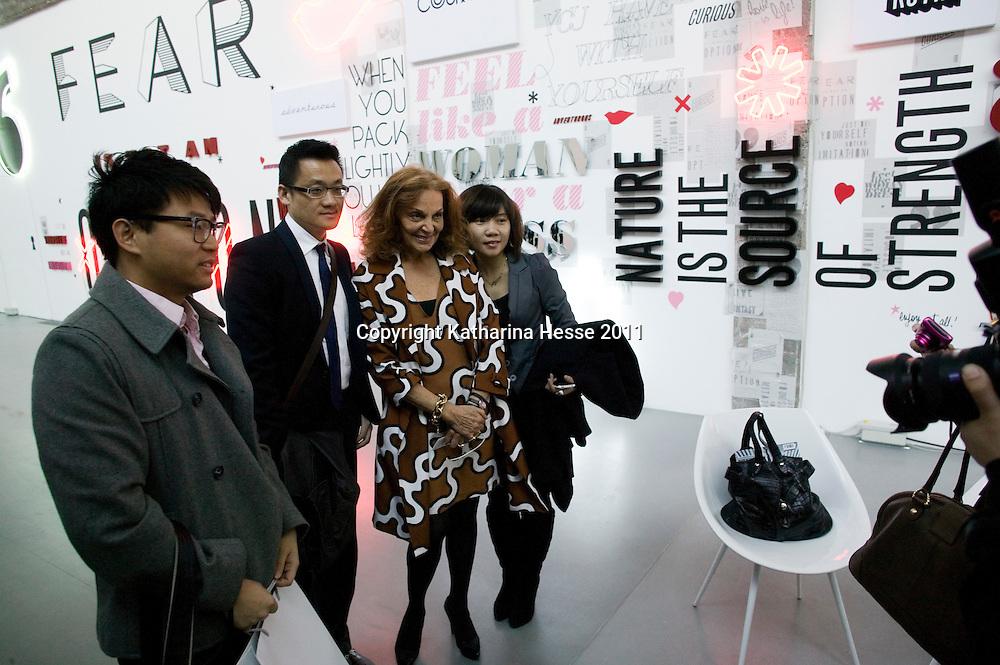 Beijing, April,2, 2011 : Diane von Furstenberg  and Chinese admirers get their picture taken.