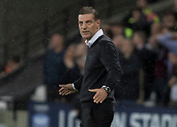 Football - 2017 / 2018 Premier League - West Ham United Vs Huddersfield Town<br /> <br /> Slaven Bilic, Manager of West Ham United, looks on at the action with a resigned look on his face at the London Stadium<br /> <br /> COLORSPORT/DANIEL BEARHAM