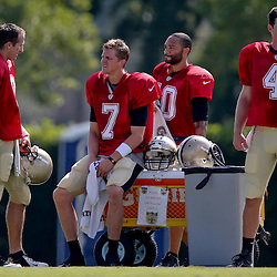 Jul 29, 2013; Metairie, LA, USA; New Orleans Saints quarterback Drew Brees (9) with quarterbacks Luke McCown (7) and Seneca Wallace (10) and Ryan Griffin (4) during a morning training camp practice at the team facility.  Mandatory Credit: Derick E. Hingle-USA TODAY Sports