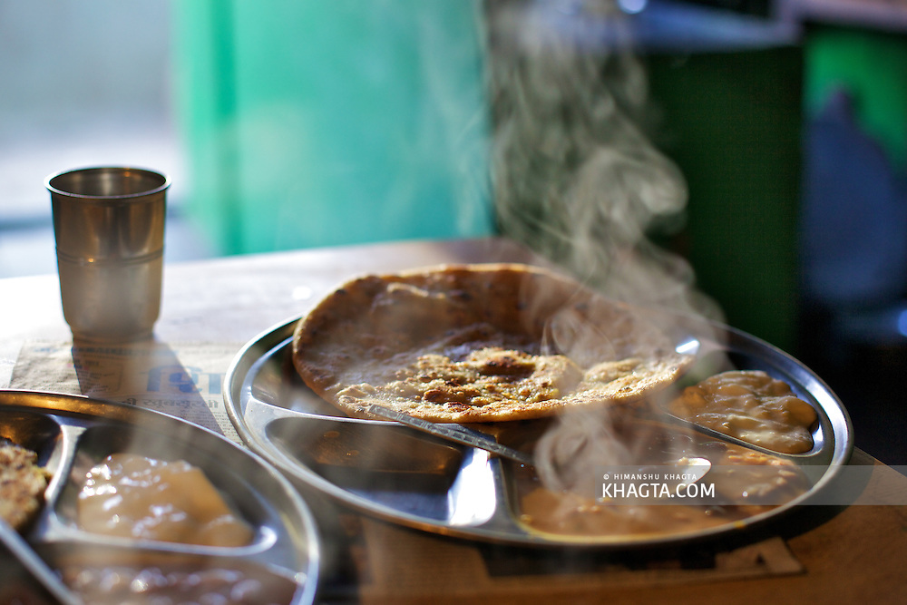 Indian Breakfast of Stuffed 'Parantha' with lentils and curd at Sangla, Kinnaur..In winters all the shops and resthouses remain closed and the only 'Dhabas' that are open have almost no choice of food.