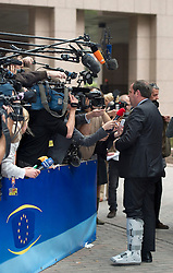 Josef Proell, Austria's finance minister, makes a statement to the media as she arrives for the emergency meeting of European Union finance ministers in Brussels, Belgium, on Sunday, May 9, 2010.  European Union finance ministers meet today to hammer out the details of an emergency fund to prevent a sovereign debt crisis from shattering confidence in the 11-year-old euro. (Photo © Jock Fistick)