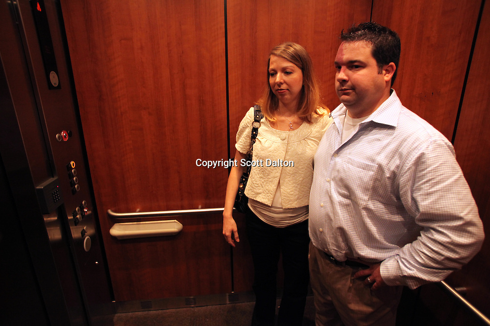 Tom and Amanda Stansel ride the hospital elevator en route to visit their surviving babies in Houston, TX on Wednesday, September 9, 2009. The couple conceived sextuplets via IVF. Amanda carried all six babies to term, but three have since died. (Photo/Scott Dalton)