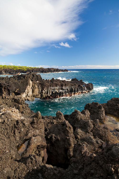 Maui, Hawaii. Waianapanapa State Park in Hana, Maui, HI.  Pictured is the lava bridge painted by Georgia O'Keeffe in 1939