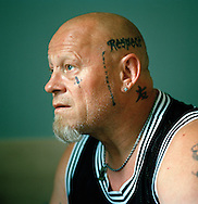 Halden Prison, Norway, June 2014:<br /> In his late 40&acute;s, inmate Tom has spent more of his adult life in prison than outside. Last time he was out he also had a serious motorcycle accident that almost killed him. In addition tho the tattoos on his left side, he also has &quot;F*** the Police inked on the right side of his skull.<br /> -- No commercial use --<br /> Photo: Knut Egil Wang/Moment/INSTITUTE