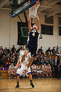 Essex's Eli DiGrande (4) leaps to dunk the ball during the boys basketball game between the Essex Hornets and the Colchester Lakers at Colchester High School on Tuesday night December 15, 2015 in Colchester. (BRIAN JENKINS/for the FREE PRESS)