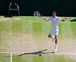 LONDON, ENGLAND - Friday, July 4, 2014: Novak Djokovic (SRB) during the Gentlemen's Singles Semi-Final match on day eleven of the Wimbledon Lawn Tennis Championships at the All England Lawn Tennis and Croquet Club. (Pic by David Rawcliffe/Propaganda)