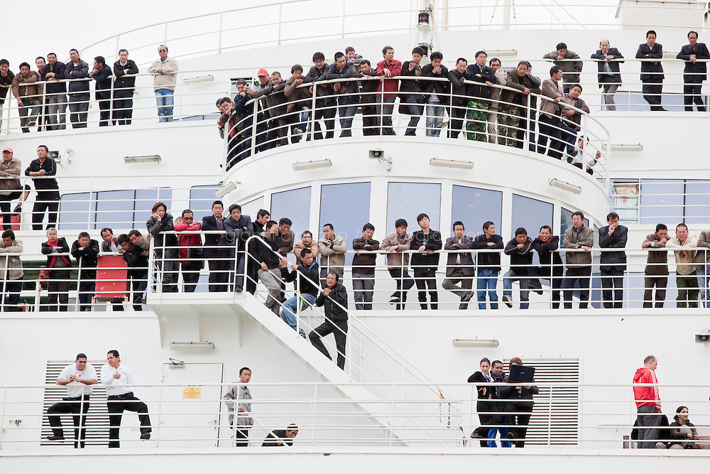 26 February 2011. Valletta, Malta. More than 2,000 Chinese passengers remain on the Chinese ferry in the harbour of Valletta, Malta,  until planes come to Malta to bring them back to China. According to a port official,  the ship evacuated 2,216 Chinese nationals, 13 Maltese, 20 Croatians, four Vietnamese and two Italians from strife-torn Libya. The vessel, Roma, is owned by Italy-based Grimaldi Lines and was chartered by the Chinese government.<br /> <br /> &copy;2011 Gianni Cipriano<br /> cell. +1 646 465 2168 (USA)<br /> cell. +39 328 567 7923<br /> gianni@giannicipriano.com<br /> www.giannicipriano.com