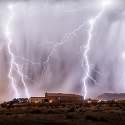 Literally 30 seconds after making this exposure, lightning stuck where my tripod had stood. When the monsoonal flows come to the Mojave desert in southern Nevada, storms like this spring up frequently and with little warning. This image (a single exposure) displayed all the mighty power that nature can bring, with sheets of rain, multiple bolts and deafening thunder. Thirty mile-per-hour wind drove the storm directly at me while I set up my gear and tested the exposure, then began making exposures to capture the action. Never underestimate the power of nature . . . and always be prepared.
