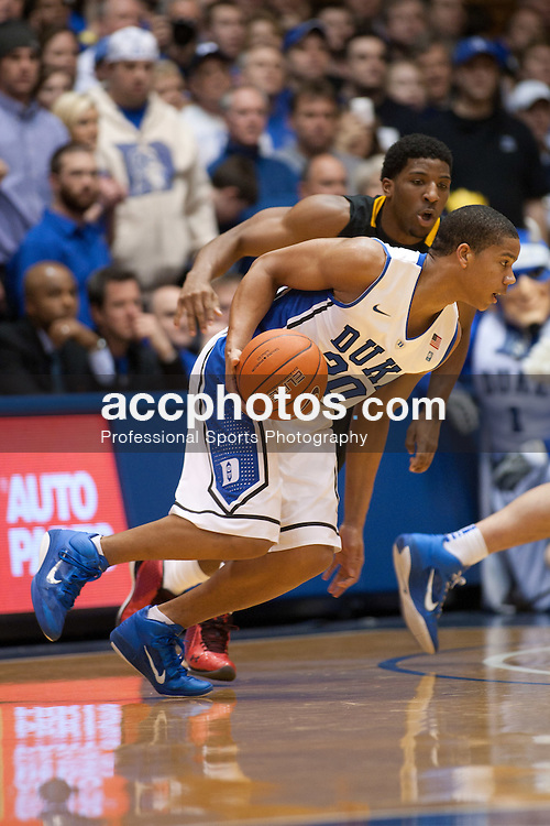 DURHAM, NC - JANUARY 09: Andre Dawkins #20 of the Duke Blue Devils dribbles the ball while playing the Maryland Terrapins on January 09, 2011 at Cameron Indoor Stadium in Durham, North Carolina. Duke won 71-64. (Photo by Peyton Williams/Getty Images) *** Local Caption *** Andre Dawkins