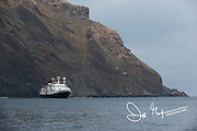 A ship anchors off the coast of Isabela island, part of the Galapagos islands of Ecuador.