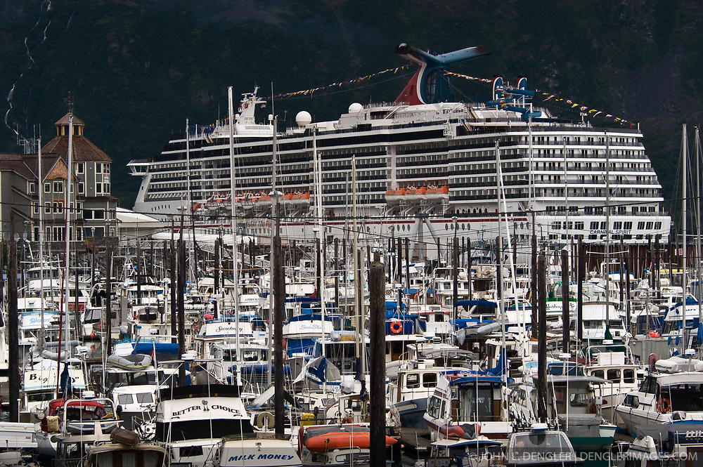 The Carnival cruise line ship, Carnival Spirit, looms over the crowded Whittier boat harbor during a port call to the small town on Prince William Sound in Alaska.